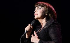 French singer Mireille Mathieu performs on stage at the Olympia concert hall in Paris on October 24, 2014, during a concert celebrating the 50th anniversary of her career. Mathieu celebrates her career of 50 years with an anniversary tour starting with three concerts at the Paris Olympia from October 24 to 26, and a triple best-of CD released on October 6 including  eight new songs.  AFP PHOTO / BERTRAND GUAY